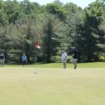 A foursome of golfers.