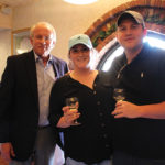 Matt Carpenter, Sales Representative, Angelini Wine with Molly Cannon, Wait Staff and Steven Gray, Food and Beverage Manager, both of Clinton Country Club.
