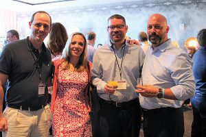 "Andrew Hastings, Moon Distributors, Inc. with Eder Bros., Inc. attendees Jennifer Caulfield, Michael McGrath and Ed Weissauer. Caulfield said of the event, ""The conference was a great event to learn and network with professionals in our industry, and bring fresh and new ideas to Connecticut."""