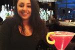 """Samantha LaPoint, bartender, Eleven 49, next to """"Flower Power"""" cocktail."""