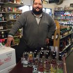 Matthew Barry, Sales Representative, Northeast Beverage Corp., presenting Ozone Vodka at Gordon's Yellow Front Wines in New London.