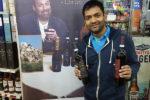 Neil Patel, Owner, Thompson Liquors, showcasing Guardia 33 wines.