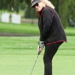 Dale Venturini, RI Hospitality Association President and CEO, lines up her putt.