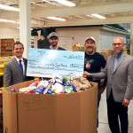 "Twin River and its employees donated $1,000 and 1,709 pounds of food to the RI Community Food Bank on June 24th to kick off the agency's annual summer food drive. Andy Moffitt, First Gentleman of Rhode Island; Adam ""Opie"" Oppenheimer, Bartender, Twin River Casino; Frank Martucci, General Manager, Beverage Operations, Twin River Casino; and Andrew Schiff, Chief Executive Officer, RI Community Food Bank. In total, Twin River's donation will provide 6,237 meals to those in need."