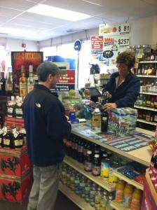 A customer checks out at Malik's Liquors in Warren.