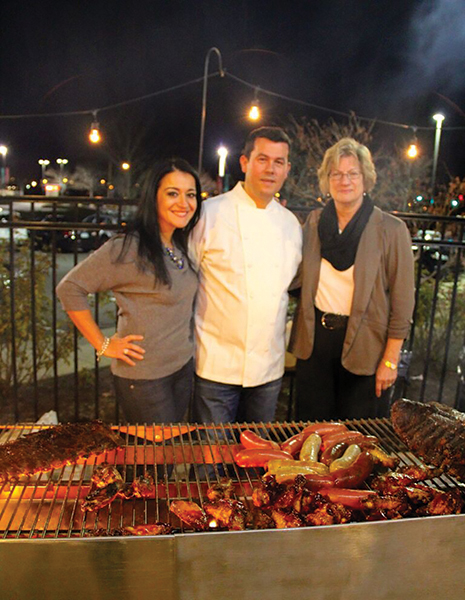 Owners Mira Puka and Chef Dorjan Puka celebrating with Mindy Rosenberg from Hartley & Parker, Ltd.