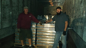 The delivery truck driver with Baxter Brewing Company's Warehouse Manager, Adam Dube.