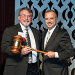 Bob Bacon, outgoing chairman of the RI Hospitality Association, passes the gavel to 2016 incoming Chairman, Bahjat Shariff of Howley Bread Group.