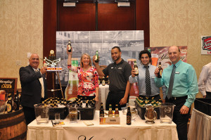 "Members of C&C's ""Team Yuengling"" celebrate at the May 8, 2014 Craft Beer Show, the day Yuengling was awarded to the team: Scott Dulieu, Rita Martin, Manny Cruz, Joe Sincerny, and Bob Zannella."