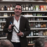 Baracchi prepares to present his Tuscan wines to guests at the Crushed Grape in Milford.