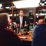 Baracchi addresses guests at Madison Wine Shop