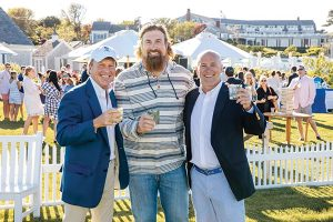Owners Bill Dessel, Matt Light and Tom McGowan at a summer event at Chatham Bars Inn.