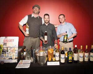 Art Chamberland, Pernod Ricard; Vito Lantz, Durk's Bar-B-Q and Statesman Tavern; Matt Guindon, Pernod Ricard, with the Lillet portfolio. Photo by Chris Almeida.