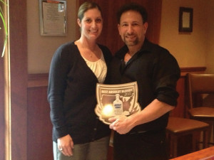 Jackie Blau presents Rob Martini his official plaque for winning Connecticut's Absolut Bloody Mary Competition held in 2013