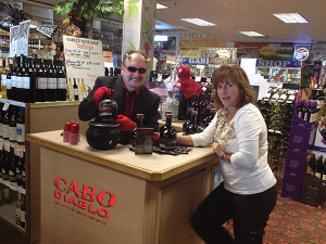 Shown with Bob Bowe (in horns) is Gina Semmonella, owner of Gabel's.