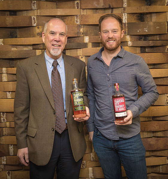 Steve Lancor, Business Manager, CDI and Chris Fredrickson, Co-owner/Distiller, Traverse City. The Straight Bourbon Whiskey is aged four years and bottled at 43% ABV, with flavors of light vanilla, citrus undertones and a smooth finish. Traverse City American Cherry infuses more than 10 pounds of Montmorency cherries in every barrel for at least two weeks, creating a hint of cherry on the finish.
