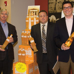 Prestige Wine Group's Vice President Chuck Andreae pictured with CDI's Business Manager Steve Drew and Ryan Sullivan, Regional Manager of Prestige Wine & Spirits presenting Kinky Gold. Kinky Gold, the newest flavor in the line that includes Kinky Blue and Kinky Pink Liqueur, is a fusion of premium vodka with a tropical blend of peach flavors.