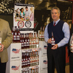 Tim Clarke, General Manager of Polly & Joan Cordial Co. and Steve Baye, Vice President of Business Management and Marketing, CDI, with Polly & Joan's Cordials. The new line of whole-cluster fresh fruit and clear-filtered handcrafted cordials from Wallingford, Conn. is available in two flavors: P&J Cold-Soaked Berries and P&J Cold-Soaked Peaches.