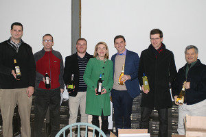 Clas (third from the right) with the Cellar Fine Wines team at their Essex, CT warehouse holding bottles of Curious Cork brands including Tuscan Sun Wines, Baracchi Winery and Faire la Fête. From left to right: CFW Hartford County Sales Representative Jake Ruder; CFW Regional Account Manager Rich Veilleux; CFW New Haven County Sales Representative Dan Reynolds; CFW Portfolio Manager Jillian Simms; Clas; CFW Fairfield County Sales Representative Jeff Schultz; and CFW Business Development Director George Carabetta.