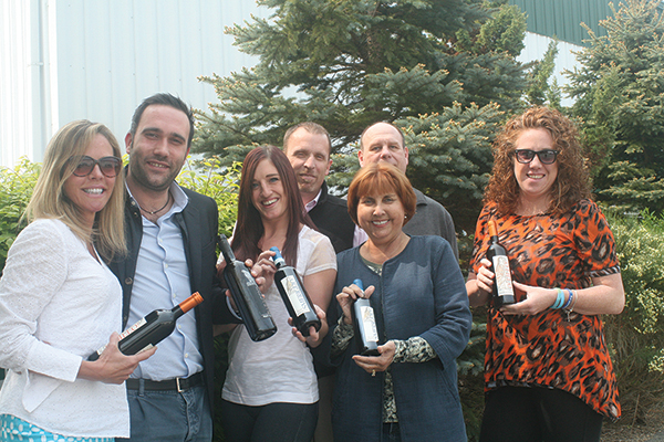 Baracchi poses with members of the Cellar Fine Wines staff outside their Essex warehouse. Left to right: Whitney Mitchell Algieri, New Haven Sales Rep., Cellar Fine Wines; Baracchi; Jenna Talbot, Hartford Sales Rep., Cellar Fine Wines; Rich Veilleux, Sales Manager, Cellar Fine Wines; Janeen Carabetta, Managing Partner; John Stapienski, Middlesex and New London Sales Rep., Cellar Fine Wines; Jacey Haskell, Fairfield Sales Rep., Cellar Fine Wines.