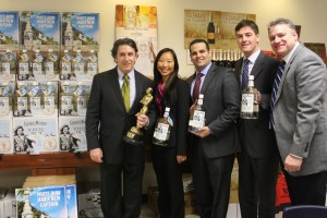 Steve Lentz, General Sales Manager, Brescome Barton; Kim Maciejewski, Diageo Marketing Manager, CT; Dominic Italiano, Diageo Distributor Manager, CT; Steve Giles, Diageo Sales Director, CT; and Dan Miller, Dedicated Trade Development Manager for Diageo and Moët Hennessy, Brescome Barton. Lentz is holding a Calvin award, given to Brescome Barton in 1984 by the Calvert division of Seagrams, for first place in their division in selling Captain Morgan Spiced Rum.