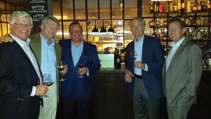 Teddy Bobroske, Senior Vice President, Webster Bank (third from left) with S. Garret Stonehouse, Owner, Aventine Hill Importers (second from right) surrounded by a group of guests from the wine tasting.