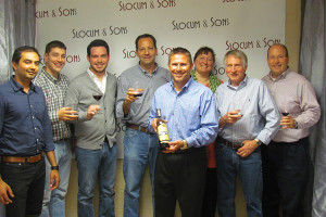 Dan Campbell, New England Regional Manager, Wagner Family of Wine (holding the bottle) and Slocum & Sons sales representatives.