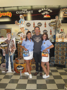 """Big Orange Productions' Rhode Island sales ambassador, Christina Leigh (interviewed in the story) with Mike Wolfe of the History Channel's reality show """"American Picker,"""" at the launch of his American Vintage Hard Tea, and sales ambassador Katie Crompton."""