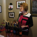 Claire Berntson pours in the tasting room.