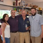 Staff of Vino et all: Serena Pagano, Cashier; Ryan Hackett, Store Manager; Ty Nicholson, Wine and Spirit Manager; Ryan Perodeau, Beer Consultant.