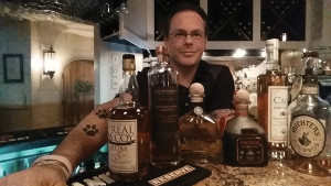 Anthony DeSerio, guest columnist, with the spirits used in the accompanying fall cocktail recipes.