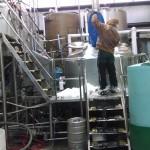 Derek Luke adding snow to brew kettle.