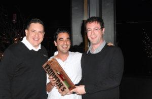 DePasqua receiving the award from Medvegy and Pelliccio.