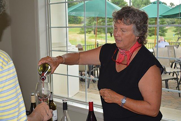 Donna Hutchinson is shown pouring at a 2015 Winebow of Connecticut tasting.