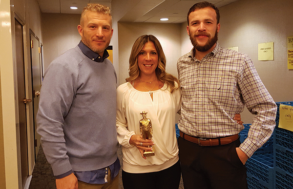 All of Eder Bros., Inc.: Jason Miller, Brown-Forman Wine Portfolio Winner; Nancy Peduto, Brown-Forman On-Premise Representative of the Year, holding a 2016 Golden Jack statuette; and Vin Rossetti, Brown-Forman Tequila Portfolio Winner.