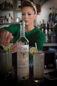 "Mia Sarazen, portfolio ambassador from Back Bar Project, demonstrates use of the mezcals making two of her creations, ""Smoke and Flowers"" and ""Titsi on the Fly."" Photo by Chris Almeida."