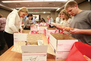 Volunteers and employees were able to create care packages to send to deployed troops with the help from Packages From Home.