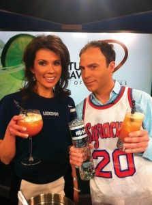 "As part of its local debut, Erika Arias and Jimmy Altman from Fox News CT ""Morning Extra"" pose with the ""There's a New Dog in Town Husky Hoop Heaven,"" a cocktail created with Husky Vodka, newly distributed by WINAM Wines. The cocktail was featured on the morning show news broadcast April 5, 2013. The drink is made to look like a basketball and there are eight blueberries as a garnish; seven represent the UCONN Husky Women's seven titles and the eight is for ""crushing the competition and win their 8th title."""