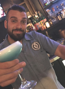 "George Zahariadis with ""Blue Drink"" cocktail"