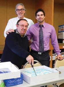 Hartley & Parker President Jerry Rosenberg and Vice President David Rosenberg present Gallant with a cake.