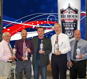 Left to right: Tito Padilla, Sales Rep, Air Force Veteran; Al Rotella, Sales Rep, Marine Veteran; Travis McVey, Owner of Heroes Vodka, Marine Veteran; Jerry Rosenberg, President of Hartley and Parker, Army Reserve Veteran; Doug Preston, District Manager, Navy Veteran.
