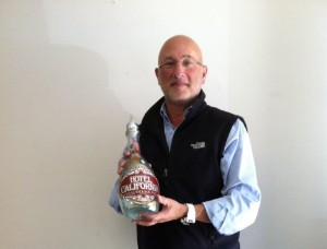 Jonathan Goldstein from Sipping Spirits, LLC holding his award winning Hotel California Tequila