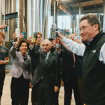 """Nico Enriquez, Co-founder, Farmer Willie's Craft Ginger Beer; Gov. Gina Raimondo; Max Easton, Co-founder, Farmer Willie's Craft Ginger Beer; Jack Reed, RI State Senator; Mayor Donald Grebien of Pawtucket; Jeremy Duffy, Co-founder and Managing Partner, Isle Brewers Guild, having a """"cheers"""" to the new opening of Isle Brewers Guild."""