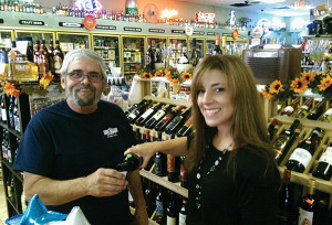 A Vine Venture brand ambassador pours Straccali wines of Tuscany from Palm Bay International at Valencia Liquors in Meriden.