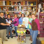 Craig Fowler, Partner, Brooklyn Wine and Spirits and Irene Tan, Owner, Brooklyn Wine and Spirits, presenting the check donation to Jean Cyr, Director of Food Pantry; Laura Kroll, Executive Assistant, Food Pantry; Pauline Millette, Assistant Director, Food Pantry; Molly Truesdale, Friends of Assisi Volunteer.