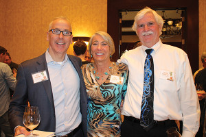 Ken Mancini, Owner, C & C Distributing, a division of Rhode Island Distributing Co.; Rita Martin, Marketing Manager and event organizer of the trade show, Rhode Island Distributing Co. with husband Shawn Martin.