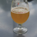 A glass of New Belgium Fat Tire Amber Ale from the outdoor patio tasting venue.