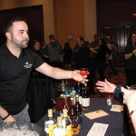 Peter Waite of Bully Boy Distillers serving cocktail samples to guests.