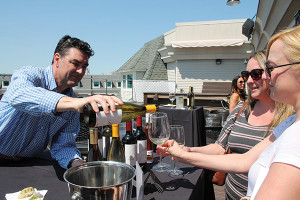 Terry Connaughton, Regional Sales Manager New England, Boisset Collection, pouring a wine sample for Natashia Fortin and Leila Regele, Hilltop Restaurant in Willington.