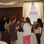 Cara Lynch-Passarelli pours at Brescome Barton's spring wine show at The Waverly Inn in Cheshire.
